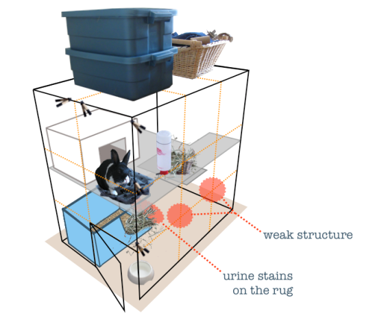 Image of a two-level cube condo with accessories and a little black and white rabbit